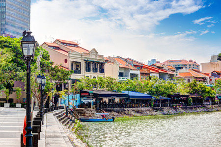rende: Colorful bars and restaurants dot the Singapore River along Boat Quay. The area used to be a commercial center during the colonial era where warehouses are located. Now, it is converted into a popular meeting place for locals and tourists alike. HDR rende