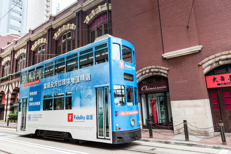 electric tram: An electric tram bus turns into Morrison St in the downtown Central District of Hong Kong. These historic streetcars have been in operation since 1904.