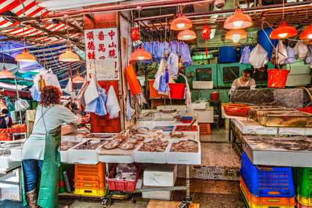 Vendors of a live seafood store on Graham Street prepare their store for business in the Central District of downtown Hong Kong for the last time March 30, 2015.