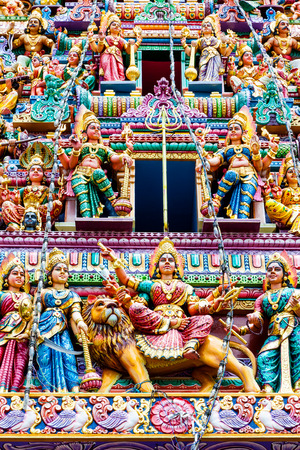 little colours: Intricate Hindu art and deity carvings on the facade of Sri Veeramakaliamman Temple in Little India Singapore.