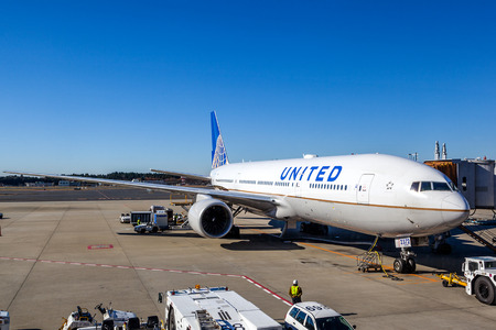 A United Airlines plane being serviced on the tarmac of Narita Airport. After its merger with Continental in 2010 United has become the world's largest airline.