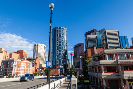 calgary: Caglary, Canada - June 21, 2015: Downtown Calgary with its iconic Calgary Tower and The Bow, as viewed from the Centre Street Bridge in Chinatown. At 774 ft, The Bow is the tallest office building in Canada outside of Toronto. Editorial