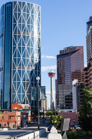 tallest bridge: Caglary, Canada - June 21, 2015: Downtown Calgary with its iconic Calgary Tower and The Bow, as viewed from the Centre Street Bridge in Chinatown. At 774 ft, The Bow is the tallest office building in Canada outside of Toronto. Editorial