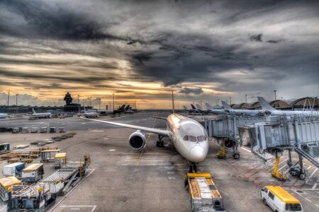 aircraft: HDR rendering of a golden sunset over Hong Kong International Airport on the island of Chek Lap Kok.