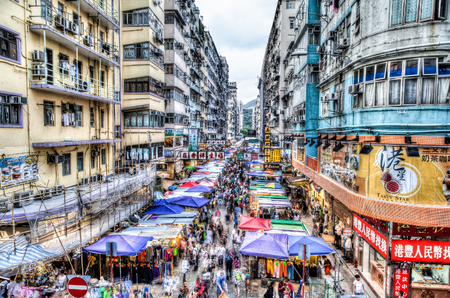 The busy Fa Yuen street market in Hong Kong. The area is popular with tourists and locals for its cheap food and fashion clothing. HDR rendering with long exposure to create crowd motion effect.