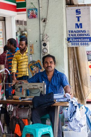 alteration shop: A roadside tailor offering cheap alterations and tailoring services in Little India, Singapores buzzing historic area renowned for its vibrant Indian community and bargain shopping and eateries. Editorial