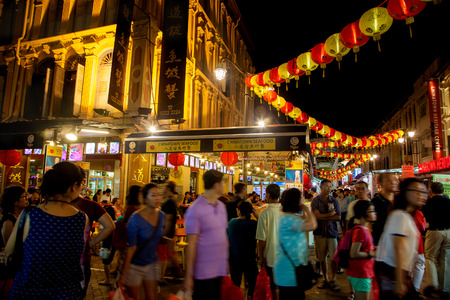 singapore culture: Chinatown attracts a crowd during Chinese New Year festivities. The area is well decorated with traditional lanterns and popular with locals and tourists alike.