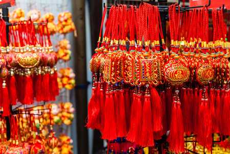 knick: Chinese New Year ornaments on sale in Chinatown. These common ornaments have the Chinese words meaning Blessings and Peace printed on them. They are typically hung at home to signify good luck.