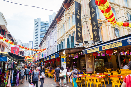 Shoppers visit Chinatown during Chinese New Year festivities for bargain souvenirs and authentic local food. The old Victorian-style shophouses are a trademark of this popular area.