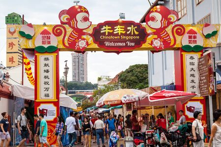 chinese new year food: Shoppers visit Chinatown during Chinese New Year festivities for bargain souvenirs and authentic local food. The old Victorian-style shophouses are a trademark of this popular area.