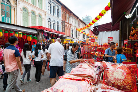 bargain for: Shoppers visit Chinatown during Chinese New Year festivities for bargain souvenirs and authentic local food. The old Victorian-style shophouses are a trademark of this popular area.