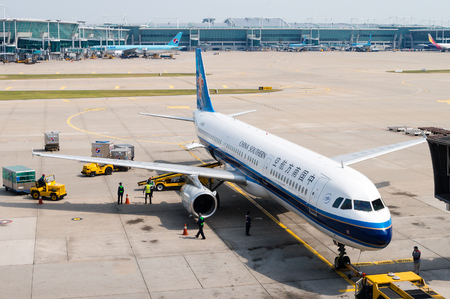 southern: A China Southern Airlines plane being serviced on the tarmac of Tokyo Narita Airport. Headquartered in Guangzhou, China, the airlines is the worlds sixth-largest measured by passengers carried and Asias largest airline in fleet size and passengers carri Editorial
