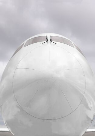 nose close up: Close-up of the front of a commercial aircraft nose cone.