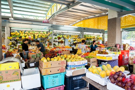 market place: Local residents shopping for fruits and vegetables at a local wet market in Singapore. For residents, a wet market is the place to buy groceries and the freshest produce. Editorial