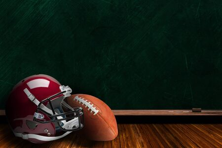 Football helmet and ball on a background chalk board with copy space.