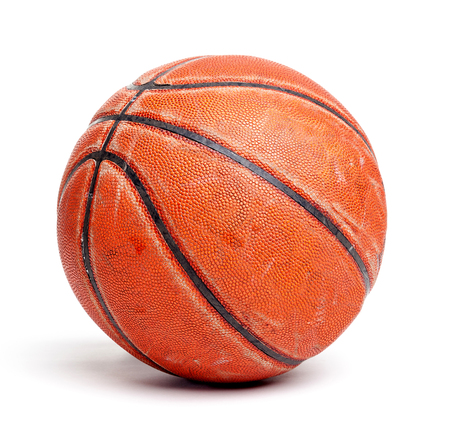 worn: An old rugged and worn out basketball isolated on white background.