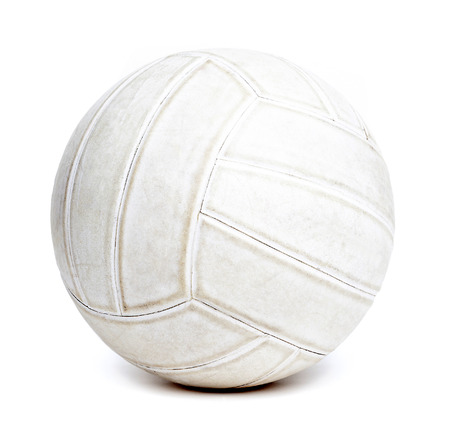 scuffed: An old rugged and worn out volleyball isolated on white background.