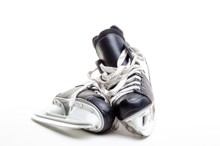 hockey skates: A pair of ice hockey skates isolated on white background with copy space. Stock Photo