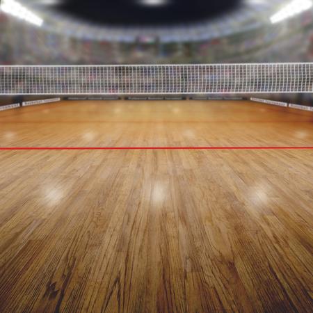 arène de volley-ball pleine de fans dans les tribunes avec un accent délibéré sur le premier plan et la profondeur de champ sur fond net et cour. Projecteurs flare pour un effet et une copie de l'espace.