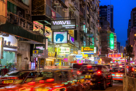 eating area: Cars streak along busy Sai Yeung Choi Street in Mongkok, Kowloon, as colorful billboards light up the area at night. The area is famous for shopping and eating.