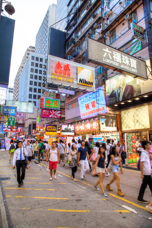 Hong Kong, China - August 7, 2013: A crowd walking along famous Fa Yuen street in Mong Kok, Kowloon. The area is popular with tourists and locals for its cheap food and fashion clothing. Vertical orientation. Redakční