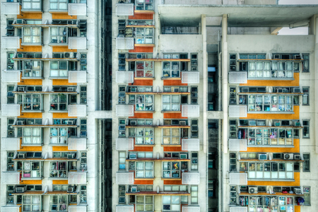 crowded space: Old crowded public housing apartments in Hong Kong. Due to a lack of land space, the majority of Hong Kongers live in closely packed high-rise apartments. HDR rendering.