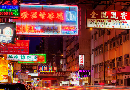 streaks of light: Colorful billboards and light streaks from traffic along busy Sai Yeung Choi Street in Mongkok, Kowloon. The area is famous for shopping and its many eateries. Editorial