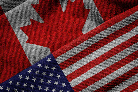canadian flag: 3D rendering of the flags of USA and Canada on woven fabric texture. Detailed textile pattern and grunge theme.