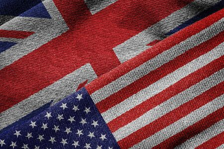 bandera reino unido: 3D rendering of the flags of USA and UK on woven fabric texture. Detailed textile pattern and grunge theme. Foto de archivo