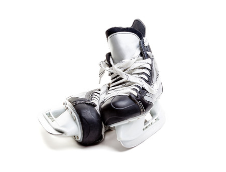 Close up on a pair of ice hockey skates with loose laces isolated on white background with copy space.