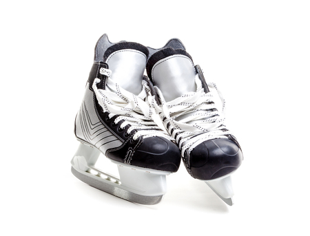 hockey skates: Close up on a pair of ice hockey skates with loose laces isolated on white background with copy space.