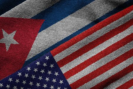 usa flags: 3D rendering of the flags of USA and Cuba on woven fabric texture. Detailed textile pattern and grunge theme. Stock Photo