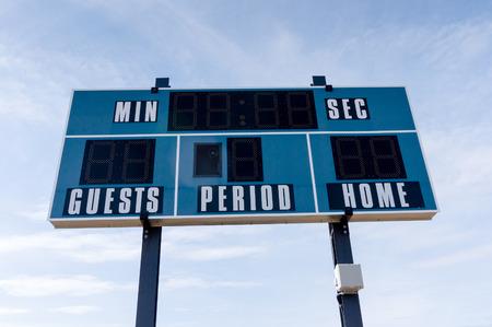 Closeup of an electronic scoreboard at a local soccer cum football field.
