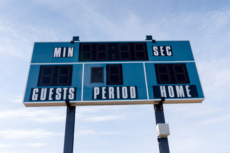 Closeup of an electronic scoreboard at a local soccer cum football field.
