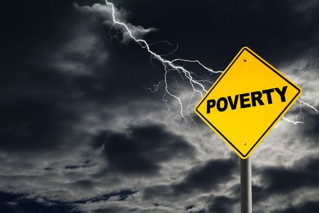 Poverty warning sign against a dark, cloudy and thunderous sky. Concept of poverty without solutions.