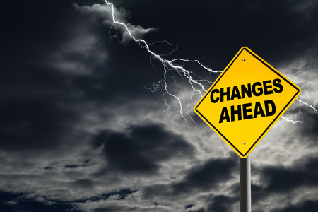 Changes Ahead warning sign against a dark, cloudy and thunderous sky. Concept of situation change for the worse.