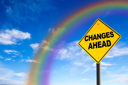 risk ahead: Changes Ahead sign against a blue sky with rainbow. Concept of situation change for the better. Stock Photo