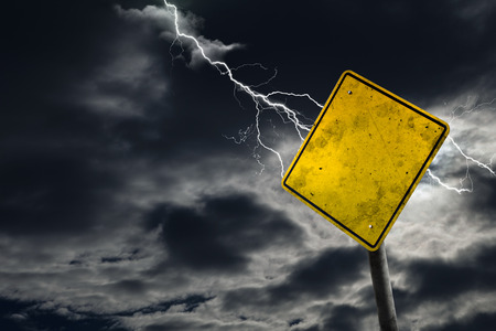 danger ahead: Empty and dirty road sign against a stormy background for any message. Concept of imminent danger and risk ahead with copy space. Stock Photo