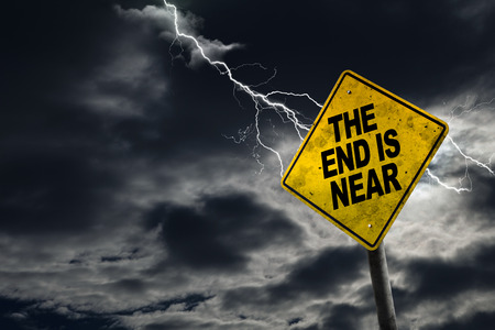 drama: End is Near sign against a stormy background with lightning and copy space. Dirty and angled sign adds to the drama.