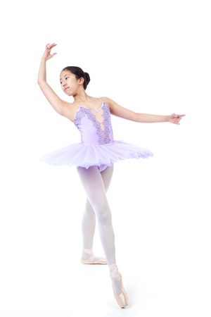 pointe shoes: Young Asian ballerina wearing purple tutu and pointe shoes dancing. Isolated on white background.