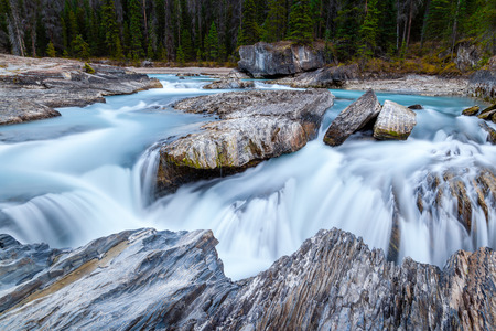 canadian rockies: Rushing waters from the Kicking Horse River carves through the rocks at Natural Bridge in Yoho National Park in the Canadian Rockies.