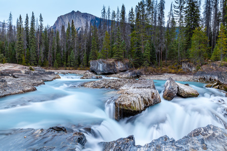 Rushing waters from the Kicking Horse River carves through the rocks at Natural Bridge in Yoho National Park in the Canadian Rockies.