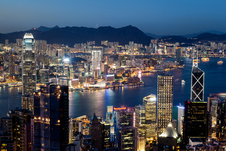 hong kong night: Colorful night scene of Victoria Harbor in Hong Kong just after sunset at the blue hour. Shot taken at Victoria Peak overlooking Tsim Sha Tsui in Kowloon.