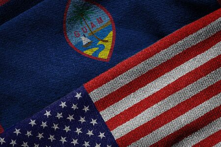 us territory: 3D rendering of the flags of USA and Guam on woven fabric texture. Guam is a U.S. territory. Detailed textile pattern and grunge theme.