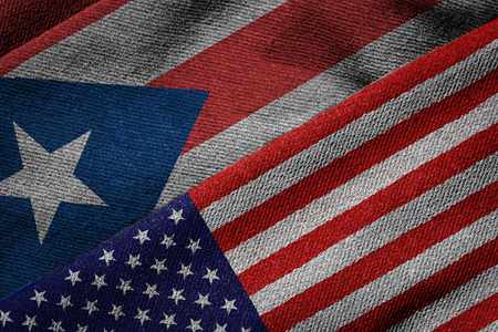 us territory: 3D rendering of the flags of USA and Puerto Rico on woven fabric texture. Puerto Rico is a U.S. territory. Detailed textile pattern and grunge theme.