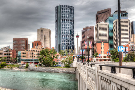 HDR rendering of Calgary downtown showing Lions Gate Bridge across the Bow River and surrounding skyscrapers.