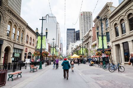 to and fro: Tourists and Calgarians alike stroll along Stephen Avenue Walk, a popular and busy pedestrian mall. Stephen Avenue Walk in downtown Calgary is a National Historical District with over 30 restored buildings in the area that feature architectural styles fro