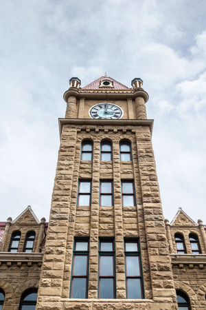 lofty: Calgary city hall with its lofty clock tower and sandstone facade.