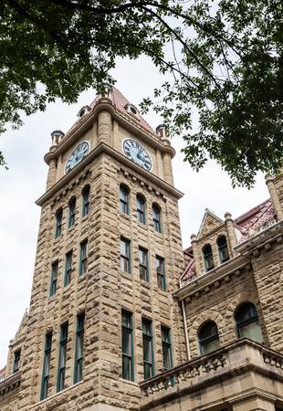lofty: Calgary city hall with its lofty clock tower and sandstone facade.