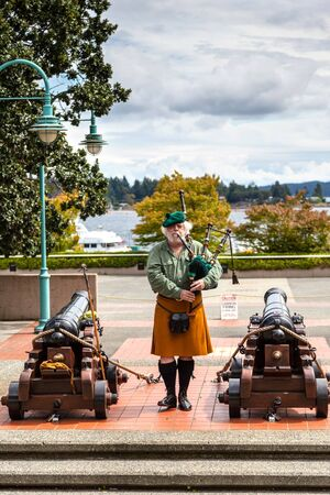 NANAIMO, CANADA - JULY 9: A Scottish bagpipe player performs prior to the daily cannon firing ceremony at the historic Bastion July 9, 2016. The daily ceremony has been an attraction over the last three decades. Nanaimo's Scottish tradition arose from the Reklamní fotografie - 60517712